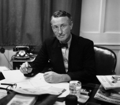 Ian Fleming at his desk