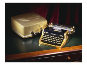 A royal quiet-de-lux-portable typewriter with gold plated body and fittings