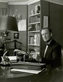 Ian Fleming at his London office