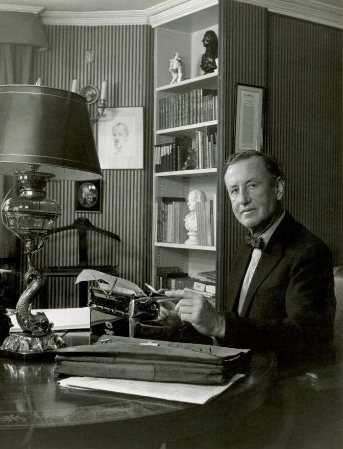 Ian Fleming at desk