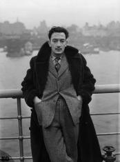 07 Dec 1936 --- Surrealist Salvador Dali stands on the deck of the S.S. Normandie as it docks in New York City. --- Image by © Bettmann/CORBIS