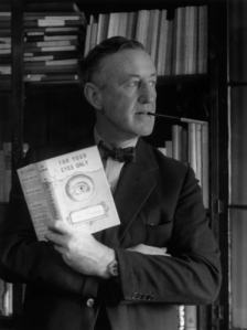 English author Ian Fleming (1908 - 1964) in his study with one of the series of James Bond novels that he wrote. (Photo by Evening Standard/Getty Images)